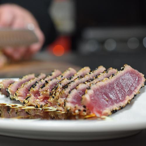 Sesame seared tuna dish on table
