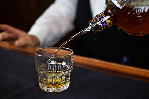Pouring Whiskey into glass at Christner's